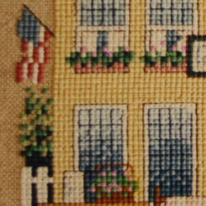 Backstitch is used only where detail is not possible with cross stitch.