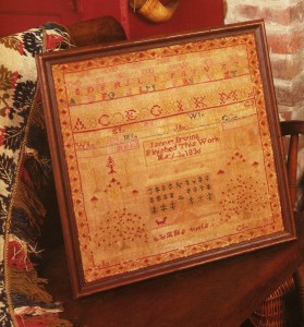The original sampler, stitched by Jannet Irving (my daughters' great-great-great grandmother). She probaby chose her own colors!